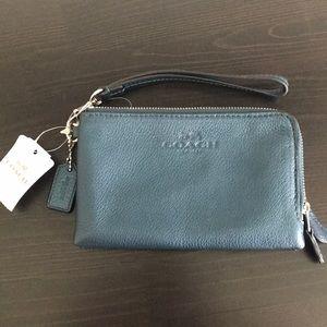 Coach metallic blue wristlet/wallet